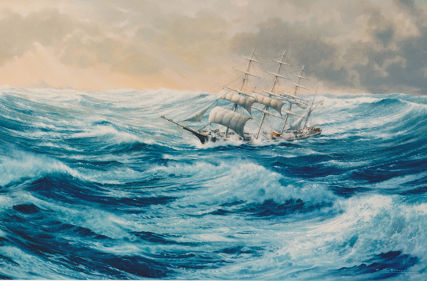 A four masted barque shortening sail off Cape Horn.
