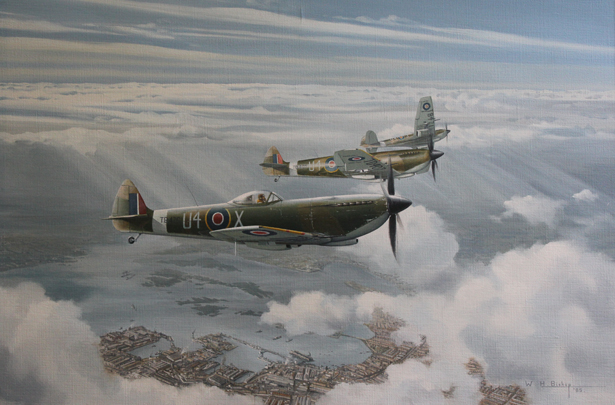 Spitfire Mk. IXVI's of 667 Squadron over Portsmouth Dockyard